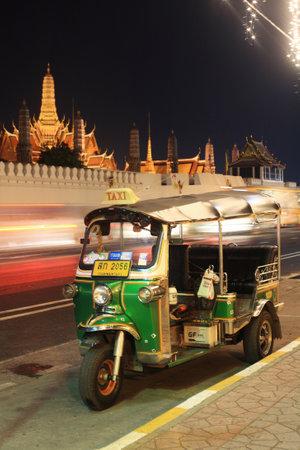 mototaxi: BANGKOK, THAILAND - DECEMBER 06, 2014: Tuktuk parking near grand palace or Wat Phra Kaew. tuk-tuk is a city popular transport moto-taxi . Editorial