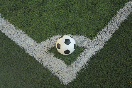 ballsport: soccer ball on the corner of artificial soccer field