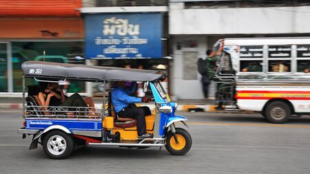 fare: KORAT, THAILAND - JULY 18, 2014: tuk tuk taxi with passengers transport in the city. Tuk tuks can be hired from as little as $1 or B30 a fare for shop trips. Editorial