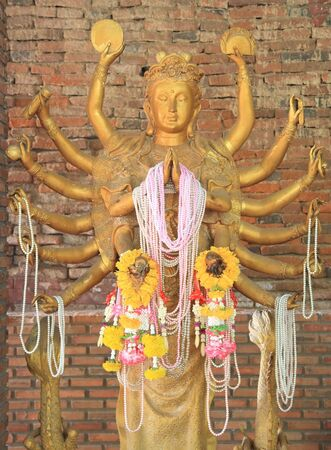 Statue of 12 Hands golden Guanyin in Korat, Thailand photo
