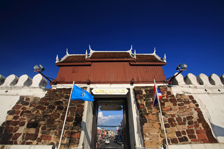 korat: KORAT, THAILAND - OCTOBER 4, 2014: Chumpol city Gate against blue sky in Nakhon Ratchasima. Chompol gate is located behind Yamo Statue in Korat downtown