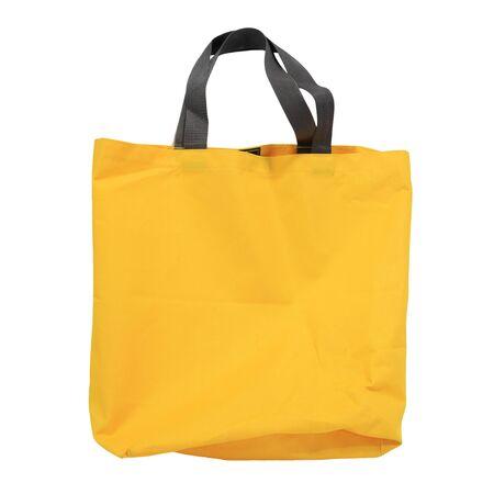 amarillo y negro: amarillo bolsa de compras de la lona aislado en fondo blanco Foto de archivo