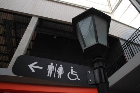 toilet index sign at the lamp post photo