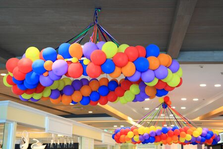 Many colorful balloons decorated in the department store photo