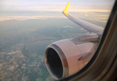 view through: View through airplane window at low altitude