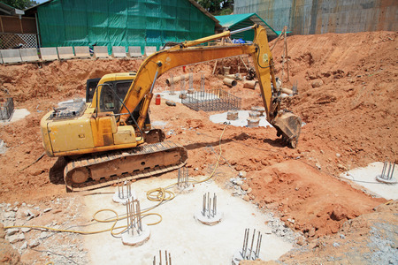 earth moving equipment: Excavator machine with bucket on construction site Stock Photo