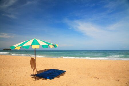 Colorful umbrella with bed sheet for visitor to relax at karon beach in Phuket. Thailand photo