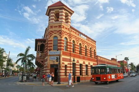hemingway: KEY WEST, FLORIDA USA - MARCH 21, 2008: view of Key West downtown with tram. It is considered the southernmost city in the continental United States.