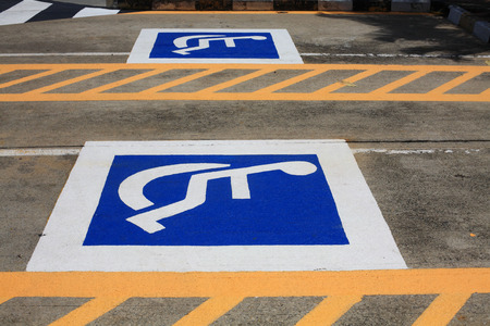 parking spaces: Outdoor car parking spaces for the Handicap Stock Photo