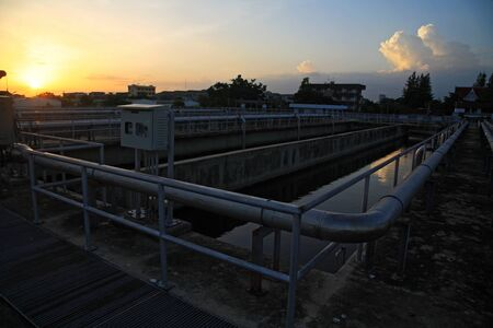 wastewater: urban wastewater treatment plant against sunset in Bangkok, Thailand