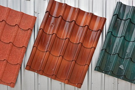 metal textures: Metal roof painted by red, brown, green color for sale Stock Photo