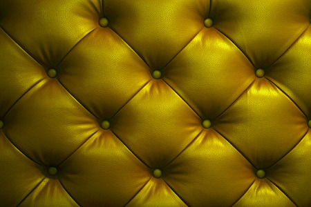 shiny gold: Vintage shiny gold leather Sofa Button for textured background