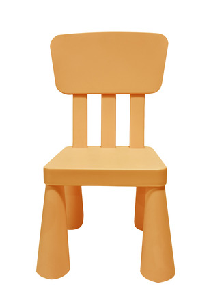 Orange children plastic chair isolated on white background