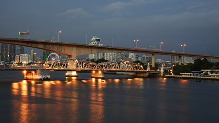 chao phraya river: BANGKOK, THAILAND - AUGUST 07, 2015: view of Krungthep Bascule bridge at dusk. Here, found in 1959, is the second bridge in Bangkok to across Chao Phraya river.