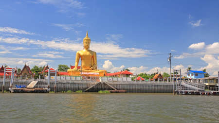 nonthaburi province: Big gold buddha statue near Chao Phraya river at wat Bang Chak in Nonthaburi province, Thailand Stock Photo