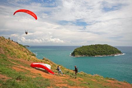 may fly: PHUKET,THAILAND - MAY 23, 2015: unidentified man preparing to fly the paramotor to enjoy Andaman sea at windmill viewpoint in Phuket. Editorial