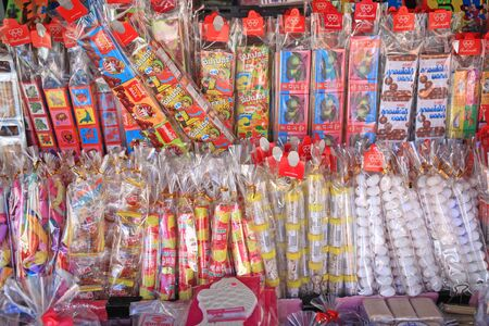 antiqued: BANGKOK, THAILAND - JUNE 29, 2015: antiqued Thai snacks on sale at the classic grocery facade. all claasic snacks are very popular for Thai people with 30 years old above.
