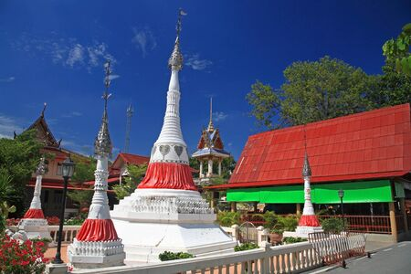 White pagodas against blue sky at wat Bang Chak in Nonthaburi province, Thailand
