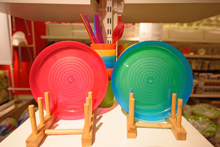 baby cutlery: Colorful Children plastic tableware for sale in store Stock Photo