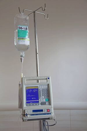 saline solution: saline solution for IV drop and medical monitor in hospital Stock Photo