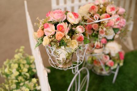 wedding arrangement. fake flower bouquet on bike