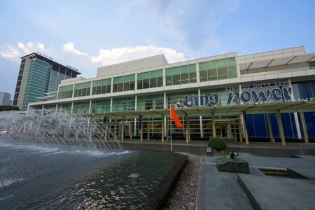 light duty: BANGKOK, THAILAND - OCTOBER17, 2015: Modern exterior of King Power duty free shopping mall with ray light. Foreign tourists are able to shop duty free in King Power.