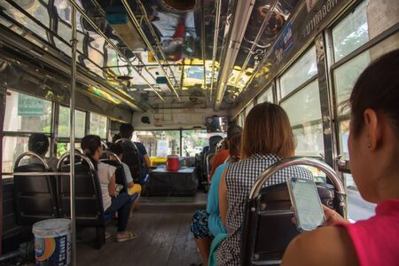 thanon: BANGKOK, THAILAND - OCTOBER 24, 2015: Unidentified Thai people on open-air Bangkok Mass Transit Authority (BMTA)  bus. BMTA bus operates more than 100 lines with fleet of 3,000 buses.