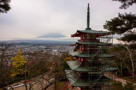 seaonal: Mt. Fuji viewed from behind Chureito Pagoda at autumn before sunset