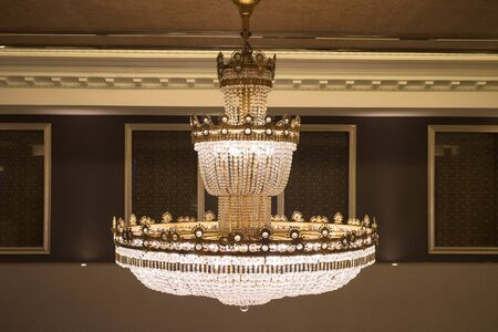 crystal chandelier: beautiful crystal chandelier decorated inside luxury building