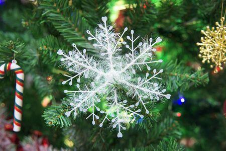 fake christmas tree: Fake snowflake decorated on a christmas tree