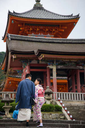 prewedding: KYOTO, JAPAN - NOVEMBER 13, 2015: Unidentified Japanese couple with traditional dress taking pre-wedding photo at Kiyomizu temple. Kiyomizu-dera is the most famous landmark in Kyoto. Editorial