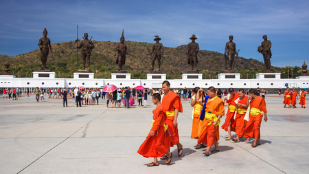 "king ramkhamhaeng: HUA HIN,THAILAND - JANUARY 17,2016 : Unidentified Thai monks visit Ratchapak  ""Kings Memorial Royal Park"". 7 famous Thai kings statues were constructed by the Royal Thai Army at Hua Hin. Editorial"
