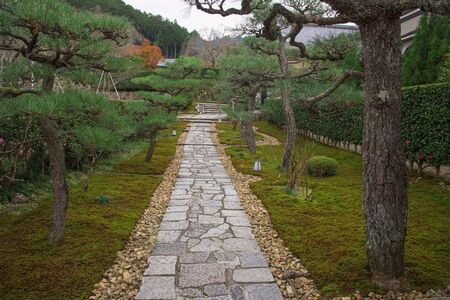 temple tank: Enkoji temple, footpath entrance with  beautiful garden in Kyoto, Japan. Here is the Rinzai Zen Sect, situated in northern Kyoto and very famous during fall colors in Autumn.