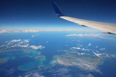 airplane above many islands and blue sea