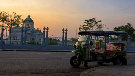tuk tuk: Thai Tuk tuk parking near Ananta Samakhom Throne Hall at dusk in Bangkok, Thailand