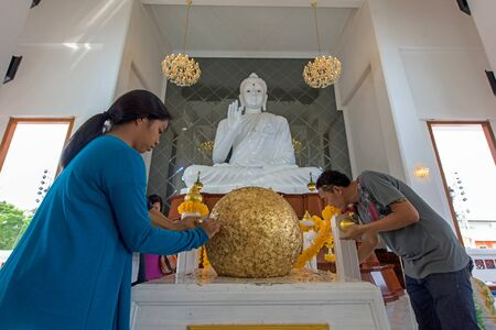 consecrated: NONTHABURI, THAILAND - FEBUARY 13, 2016: Unidentified people visit Wat Ku to sacred golden vision ball (Luuk Nimit). This ball is consecrated for temple foundation.