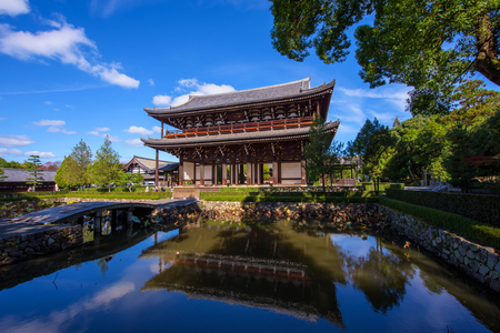 main gate: Sanmon - The main Gate with skyline reflection at Tofuku-ji Temple in Kyoto, Japan