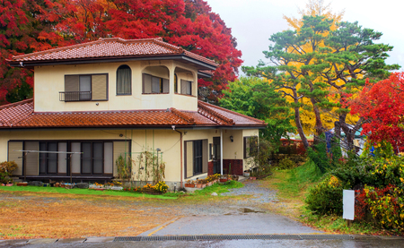 worn structure red: Modern house with autumn color leaves at Kawaguchiko, Japan