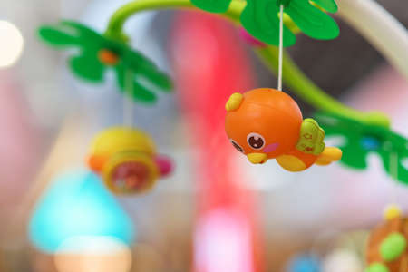 baby development: Cute hanging bird toy for baby development, Selected focus at bird Stock Photo