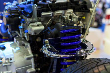 choke: Blue shock absorber or choke and modern car engine model Stock Photo