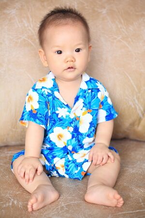 drench: Portrait of adorable boy with Songkran flower shirt to celebrate Thai new year or water festival