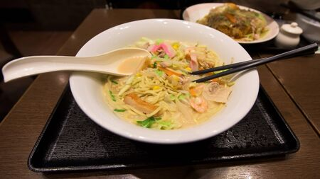 imminent: Delicious Japanese Ramen and stir-fried soba on wooden table