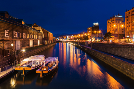 Otaru canal at night with twilight blue sky in Hokkaido, Japan