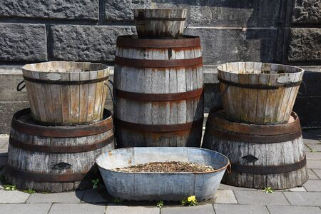 iron hoops: Old wooden buckets or barrel for exterior at Sakaimachi Street in Otaru, Japan Stock Photo