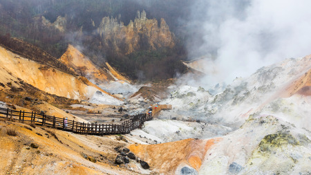 Jigokudani hell valley walking trail with heavy raining in Noboribetsu, Hokkaido, Japan