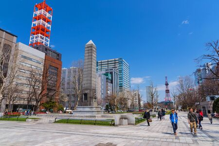 odori: SAPPORO, JAPAN - APRIL 25, 2016: Unidentified people at Odori park, the central park with TV Tower view at Sapporo.