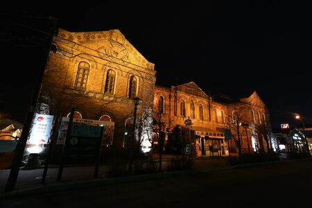 urban redevelopment: HAKODATE, HOKKAIDO, JAPAN - APRIL 21, 2016: Hakodate Meijikan, red-brick building built as Hakodate Post Office in 1911 but now used as a shopping mall.