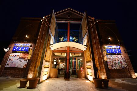 hang out: HAKODATE, HOKKAIDO, JAPAN - APRIL 21, 2016: Hakodate Beer Factory at night. Here is very popular hang out restaurant to eat and drink at evening. Editorial