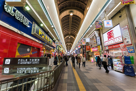 SAPPORO, JAPAN - APRIL 24, 2016: Unidentified people shopping at Pole town or Tanukikoji shopping street. Here is very famous shopping landmark near Susukino station. 新闻类图片