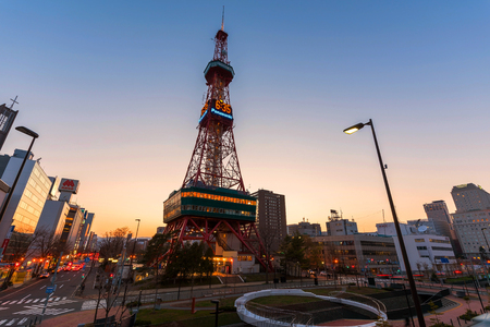 odori: SAPPORO, JAPAN - APRIL 24, 2016: Sapporo TV Tower at sunset near Odori Park. The 147.2 meter high tower has an observation deck open to tourists. Editorial